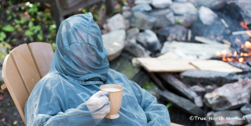 me enjoying my morning cup of java next to the fire in full bug gear